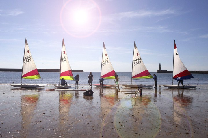Sailing yachts on beach